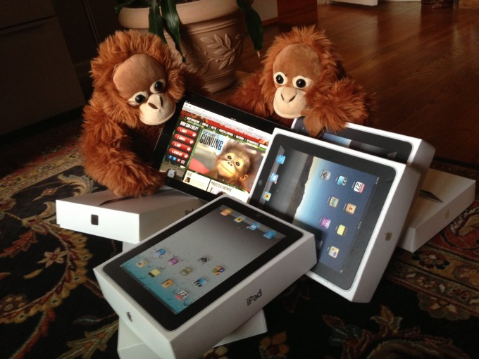 Orangutan Outreach interns inspecting iPads donated by NatGeo.